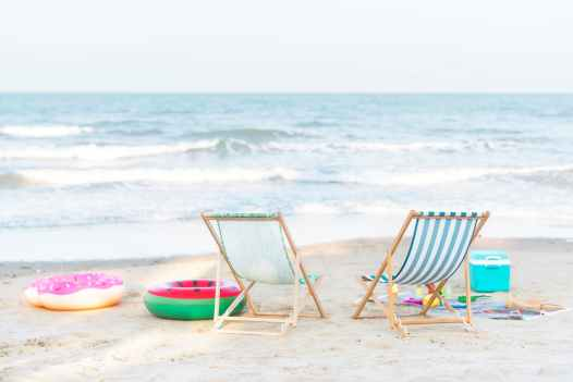 photo of beach chairs on seashore