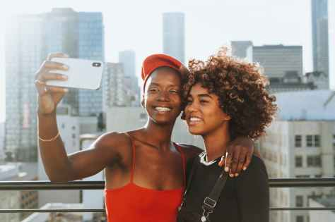 two women taking photo